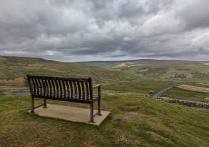 Bench seat overlooking view down valley, Swaledale, Yorkshire